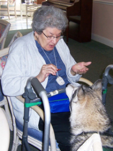 Woman with walker and dog from Paws for Peole