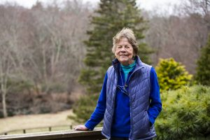 Judith Cook, a supporter of the Tufts Wildlife Clinic at the Tufts University School of Veterinary Medicine, poses for a portrait outside her home