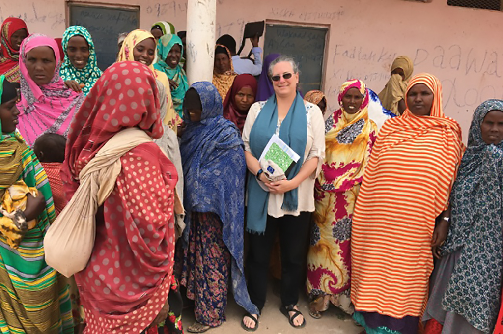 Christine Jost talks to a group of women about access to quality animal health services, while on a 2019 visit to the Somali region of Ethiopia