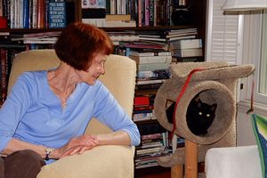 Barbara Magruder with her black cat, Beatrice