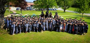 V19 commencement class on Grafton campus center lawn